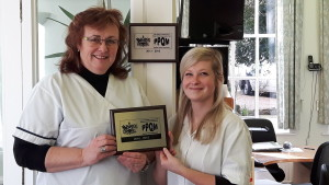 Fiona Jacobs and Emilie Bevan recieve the PPQM award on behalf of the Bury St Edmunds Chiropractic Clinic